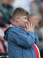 A dejected Sunderland fan watches as his team is relegated during the Sky Bet Championship match at the Stadium of Light, Sunderland.