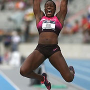 WADE - 13USA, Des Moines, Ia. - Betty Wade stretches out in the long jump heptathlon.  Photo by David Peterson