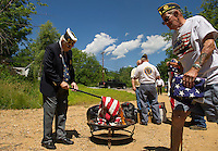 Bill Firth Commander District 7 and Bob Stevens during the VFW Post 59 ceremonial Flag Retirement at Belmont's covered bridge on Saturday afternoon.  (Karen Bobotas/for the Laconia Daily Sun)