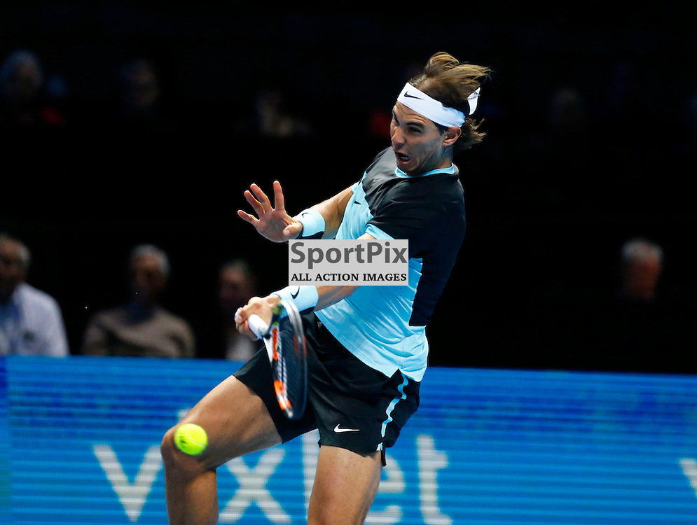 Rafael Nadal in fine form returns a ball. ATP Finals 2015 at O2 Arena, London. Stanislas Wawrinka plays Rafael Nadal in their first match in the Group Ilie Nastase. 16th November 2015. (c) Matt Bristow | SportPix.org.uk