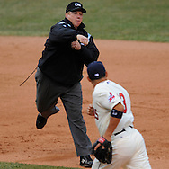 Umpire Bruce Dreckman calls interference on baserunner Orlando Cabrera as Jhonny Peralta failed to make a relay through Monday, March 31 at Progressive Field in Cleveland. The Indians defeated the White Sox 10-8.