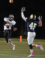 NEWTOWN, PA - OCTOBER 10: William Tennent's Nikolas Banks #4 makes a pass as Council Rock South's Michael Stock tries to deflect the ball in the second quarter at Council Rock North's Walt Snyder Stadium October 10, 2014 in Newtown, Pennsylvania. (Photo by William Thomas Cain/Cain Images)