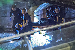 "© Licensed to London News Pictures . Manchester , UK . FILE PICTURE DATED  06/10/2013 of police carrying a body , found floating in a canal . Police pulled a body from The Bridgewater Canal in Manchester , adjacent to the City's "" Gay Village "" on Canal Street . Greater Manchester Police have issued a statement after suggestions that a number of deaths in and around Manchester's canals may be linked to a serial killer , named in local folklore as "" The Pusher "" . The statement said "" Absolutely no evidence whatsoever of foul play has been established "" . Photo credit : Joel Goodman/LNP"
