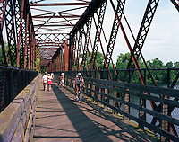 Norwottuck hike and bike trail over old railroad bridge at Connecticut River Greenway State Park, Northampton, MA