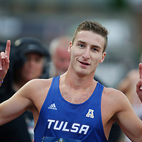 Tulsa's Marc Scott celebrates his victory in the 10,000 meter run on the first days of the he NCAA college track and field championships in Eugene, Ore., Wednesday, June 7, 2017. His time was 29:01.54. (AP Photo/Timothy J. Gonzalez)