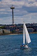 Sailboat floating on the harbor under the Sky Needle, Seattle, Washington