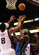 Dec. 5 2010; Phoenix, AZ, USA; Washington Wizards forward Andray Blatche (7) puts up a basket against Phoenix Suns foward Channing Frye (8) during the first half at the US Airways Center. Mandatory Credit: Jennifer Stewart-US PRESSWIRE.