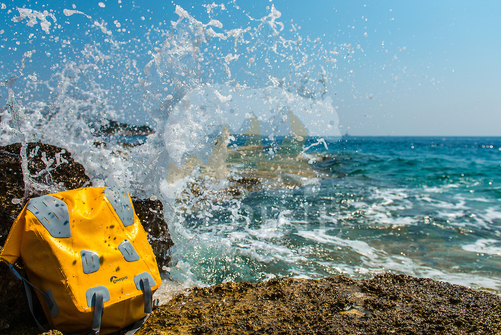 A close-up view of a photographic waterproof backpack as seen on a sunny Summer day on the Mediterranean Croatian coast of Premantura peninsula.