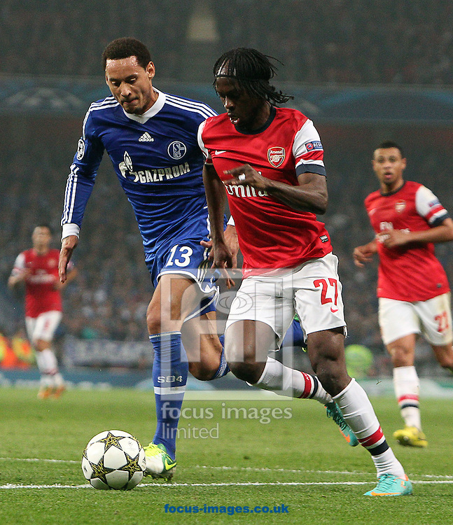 Picture by Paul Terry/Focus Images Ltd +44 7545 642257.24/10/2012.Gervinho of Arsenal and Jermain Jones of FC Schalke during the UEFA Champions League match at the Emirates Stadium, London.