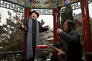 Master Li (left) and his accompanying musician Mr Deng in a temple in Luoyang Henan province, China