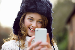 Teenage Girl Using Smartphone Outdoors