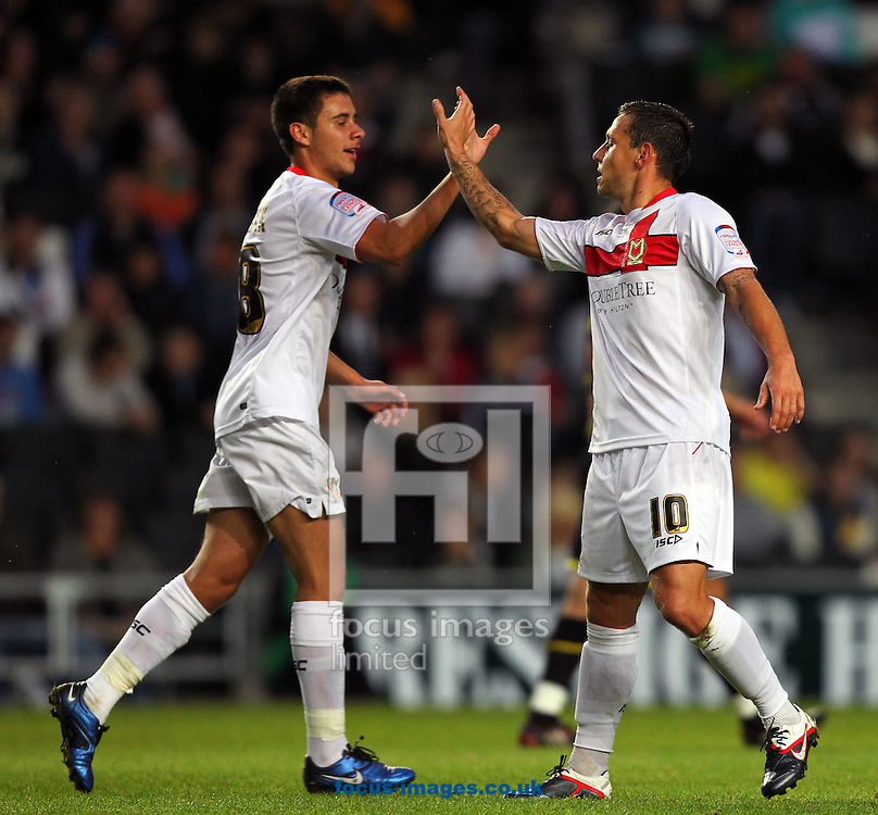 Picture by James Ward/Focus Images Ltd.  07908 205049.30/8/11.Charlie Macdonald of MK Dons celebrates scoring the opening goal  with team-mate  George Baldock of MK Dons during the Johnstone's Paint Trophy Round 1 match at stadium MK in Milton Keynes, Buckinghamshire.