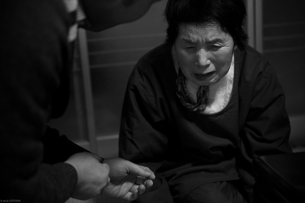 — A hand, opening, reaching out to console her, Akihiro Okumoto's grandmother wakes every morning wondering if today is the day her grandson will be hanged for a crime he committed 5 years ago. Akihiro's motive for the crime was not discovered, but determined by the presiding judge and prosecutors. Japan upholds capital punishment, but without a capital trial — prosecutors are not required to disclose their sentencing request until all the evidence has been presented and just before the defense's closing argument. There are no policies or procedures for misconduct resulting in a mistrial. Advocates for further reform are pressuring the government to make changes that guarantee transparency and genuine justice, but will it take place before Akihiro's execution?