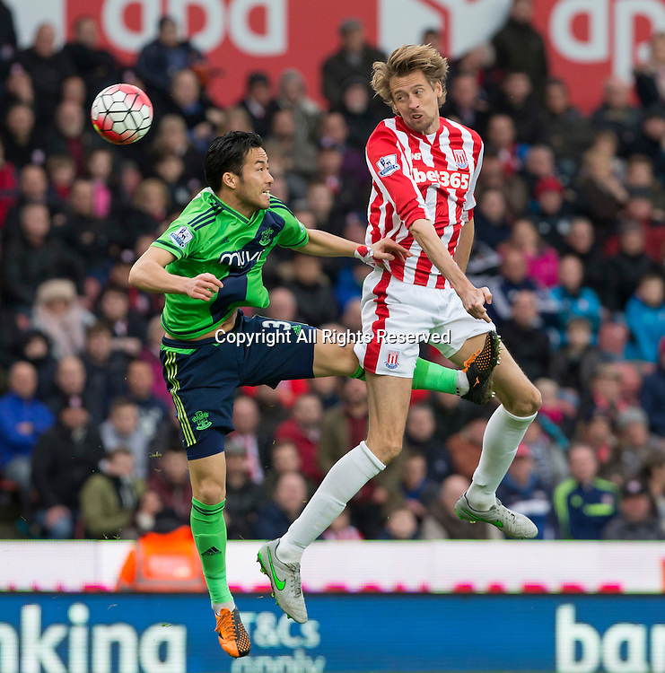 12.03.2016. Britannia Stadium, Stoke, England. Barclays Premier League. Stoke City versus Southampton. Stoke City striker Peter Crouch heads the ball at the Southampton goal.