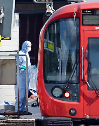 © Licensed to London News Pictures. 15/09/2017. London, UK. Forensics officers can be seen next to the evacuated tube train at Parsons Green Station after a small explosion during the morning rush hour. A number of casualties have been reported. Photo credit: Peter Macdiarmid/LNP
