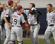 Arkansas' Tim Carver (18) is congratulated by teammates Matt Vinson (1) and Kyle Atkins (21) after hitting a two-run home run against Mississippi in a college baseball game at Oxford-University Stadium in Oxford, Miss. on Friday, May 7, 2010. Arkansas won 11-4.