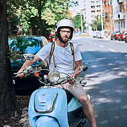 Tourist riding moped in the streets of Budapest, Hungary.