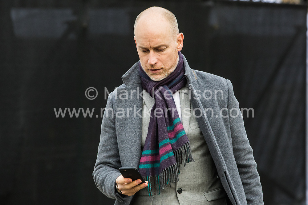 London, UK. 16 December, 2019. Stephen Kinnock, Labour MP for Aberavon, crosses College Green in Westminster as Parliament resumes following the general election.