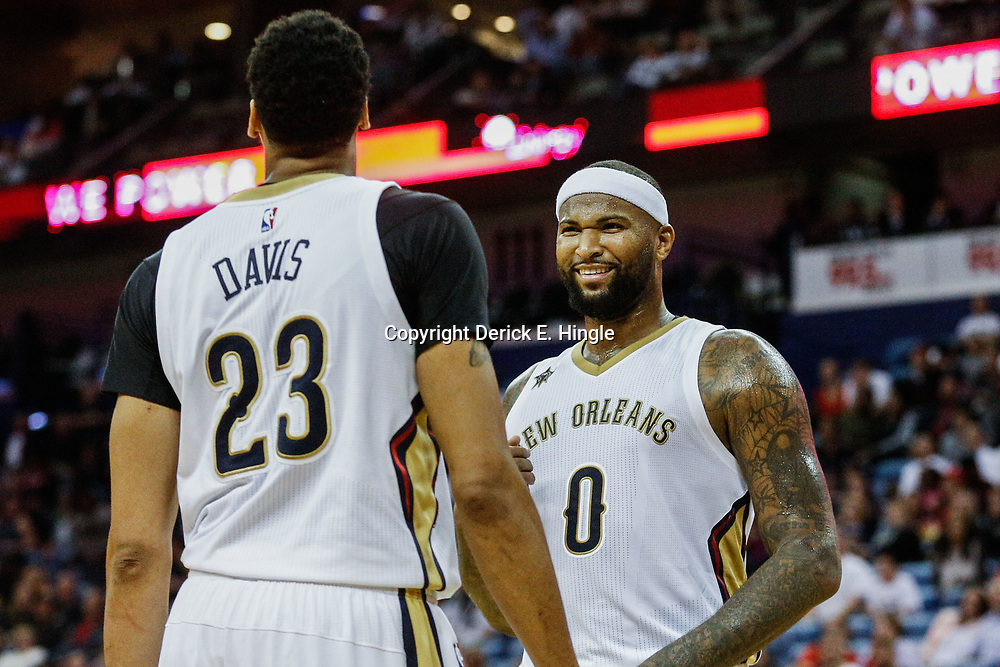 Mar 14, 2017; New Orleans, LA, USA; New Orleans Pelicans forward DeMarcus Cousins (0) celebrates after a dunk by forward Anthony Davis (23) during the second half of a game against the Portland Trail Blazers at the Smoothie King Center. The Pelicans defeated the Trail Blazers 100-77. Mandatory Credit: Derick E. Hingle-USA TODAY Sports