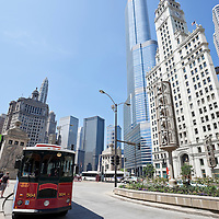 Picture of Chicago downtown with a trolley bus on Michigan Avenue inlcuding the Wrigley Building and Trump Tower. Photo is vertical, was taken in May 2010 and is high resolution.