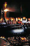 Showscan developed moving theater seats and enhanced movie projection that work together to give audiences bigger thrills.  Film is projected at 60 frames per second to enhance clarity and seats on hydraulic lifts follow movie action. Hollywood, California. Shot for the book project: A Day in a Life of Hollywood. USA.