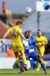 Abu Ogogo of Bristol Rovers is challenged by Dominic Gape of Wycombe Wanderers - Rogan/JMP - 10/08/2019 - FOOTBALL - Memorial Stadium - Bristol, England - Bristol Rovers v Wycombe Wanderers - Sky Bet League 1.