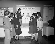 07/01/1977.01/07/1977.7th January 1977.The Aer Lingus Young Scientist Exhibition at the RDS Dublin. ..Picture shows Christine Garner, Loreto Convent, Fermoy, Co. Cork (kneeling on table ) putting the finishing touches to her exhibit 'The Honey Bee' watched by, from left, Joan O'Leary ], Elizabeth Forde, Sr. Martin, Sheila Thornhill, Marie Ryan and Anna Walshe all from the Loreto Convent, Fermoy, Cork. ..