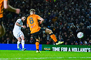 Leeds United midfielder Jack Harrison (22) takes a shot during the EFL Sky Bet Championship match between Leeds United and Hull City at Elland Road, Leeds, England on 10 December 2019.