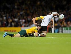 Australia Winger Rob Horne tackles Fiji Flanker Peceli Yato  - Mandatory byline: Joe Meredith/JMP - 07966386802 - 23/09/2015 - Rugby Union, World Cup - Millenium Stadium -Cardiff,Wales - Australia v Fiji - Rugby World Cup 2015 - Pool A