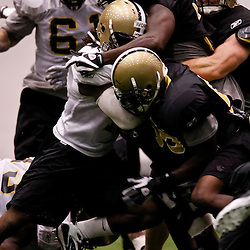July 31, 2010; Metairie, LA, USA; New Orleans Saints running back Chris Ivory (48) is gang tackled by defenders during a training camp practice at the New Orleans Saints indoor practice facility. Mandatory Credit: Derick E. Hingle