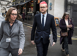 © Licensed to London News Pictures. 27/03/2018. London, UK. Christopher Wylie (C), the Cambridge Analytica whistleblower, arrives at Portcullis House to appear before a Select Committee. Cambridge Analytica has been implicated in an investigation into the misuse of Facebook user data to influence the electoral outcomes, including the Brexit referendum. Photo credit: Peter Macdiarmid/LNP