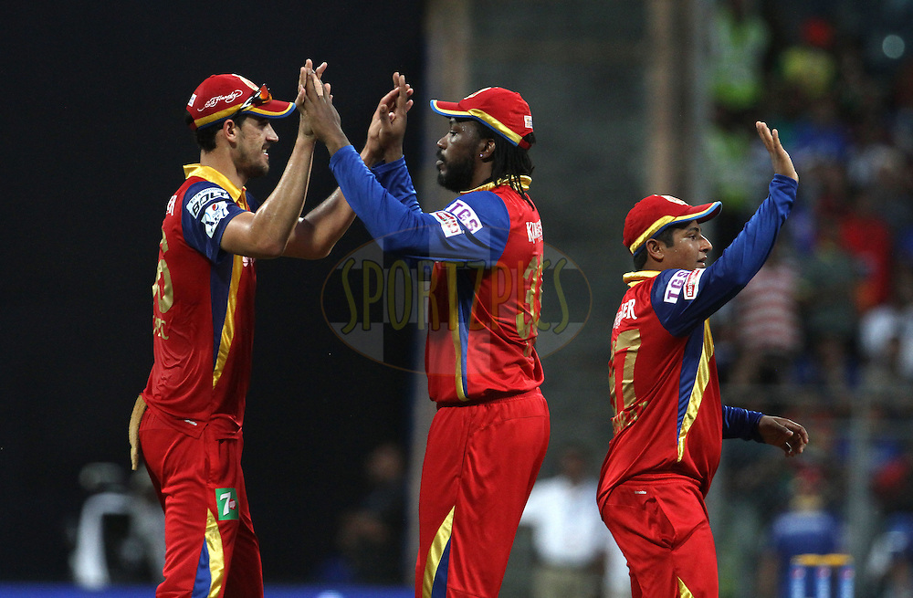 Royal Challengers Bangalore players celebrates the wicket of Mumbai Indians player Kieron Pollard during match 46 of the Pepsi IPL 2015 (Indian Premier League) between The Mumbai Indians and The Royal Challengers Bangalore held at the Wankhede Stadium in Mumbai, India on the 10th May 2015.<br /> <br /> Photo by:  Vipin Pawar / SPORTZPICS / IPL