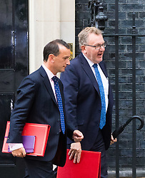 London, June 27th 2017. Welsh Secretary Alun Cairns and Scotland Secretary David Mundell (right) leave the weekly UK cabinet meeting at 10 Downing Street in London.
