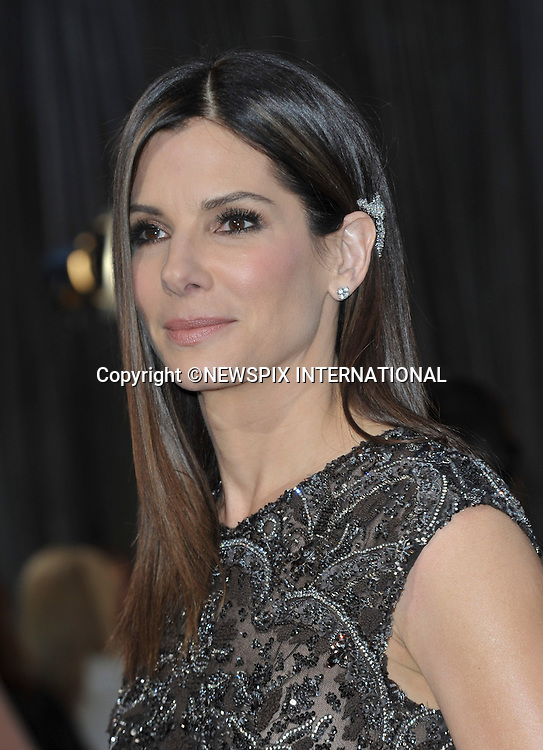 "SANDRA BULLOCK..Red Carpet arrival for the 85th Annual Academy Awards, Dolby Theatre, Hollywood, Los Angeles_23/02/2013.Mandatory Photo Credit: ©Dias/Newspix International..**ALL FEES PAYABLE TO: ""NEWSPIX INTERNATIONAL""**..PHOTO CREDIT MANDATORY!!: NEWSPIX INTERNATIONAL(Failure to credit will incur a surcharge of 100% of reproduction fees)..IMMEDIATE CONFIRMATION OF USAGE REQUIRED:.Newspix International, 31 Chinnery Hill, Bishop's Stortford, ENGLAND CM23 3PS.Tel:+441279 324672  ; Fax: +441279656877.Mobile:  0777568 1153.e-mail: info@newspixinternational.co.uk"