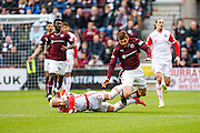Ross County Defender Andrew Davies fouls Hearts FC Forward Juanma Dalgado during the Ladbrokes Scottish Premiership match between Heart of Midlothian and Ross County at Tynecastle Stadium, Gorgie, Scotland on 24 October 2015. Photo by Craig McAllister.