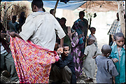 "Three days of celebration, music, food are what the people do to keep the tradition of early child marriages alive. Most of the young girls who are forced to marry consider that practice an abduction, which cause physically and emotionally violations. North West of Ethiopia, on friday, Febrary 13 2009.....In a tangled mingling of tradition and culture, in the normal place of living, in a laid-back attitude. The background of Ethiopia's ""child brides"", a country which has the distinction of having highest percentage in the practice of early marriages despite having a law that establishes 18 years as minimum age to get married. Celebrations that last days, their minds clouded by girls cups of tella and the unknown for the future. White bridal veil frame their faces expressive of small defenseless creatures, who at the age ranging from three to twelve years shall be given to young brides men adults already...To protect the identities of the recorded subjects names and specific places are fictional."