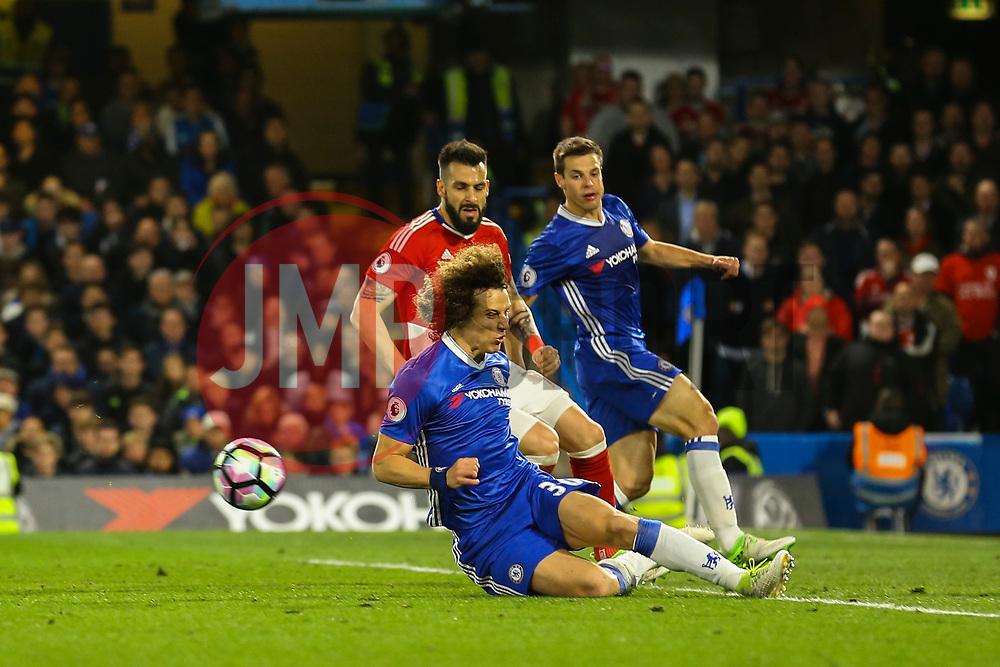 David Luiz of Chelsea clears the ball under pressure - Mandatory by-line: Jason Brown/JMP - 08/05/17 - FOOTBALL - Stamford Bridge - London, England - Chelsea v Middlesbrough - Premier League