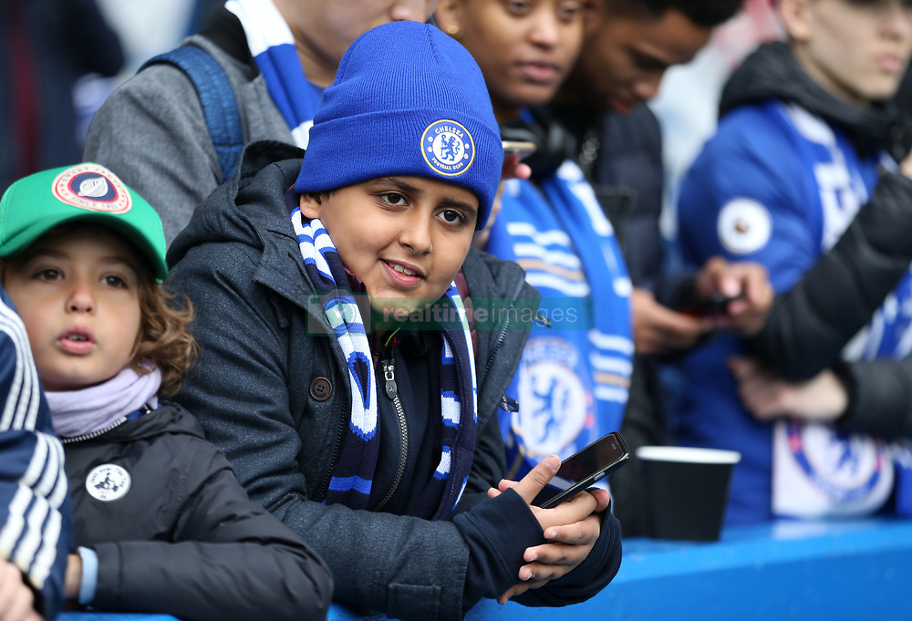 A Chelsea fan in the stands during the Premier League match at Stamford Bridge, London.