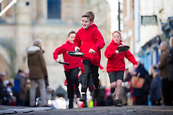 © Licensed to London News Pictures. 28/02/2017. Ripon UK. Local school children take part in the annual Shrove Tuesday pancake race today at Ripon Cathedral in North Yorkshire. Photo credit: Andrew McCaren/LNP