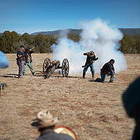 03/24/18     Daniel Zollinger<br /> <br /> Reinactment soldiers fire a canon for spectators March 24, 2018 during the annual Civil War Encampment held by the Pecos National Historical Park. A member of the reenactment group, Ken Dusenberry noted that firing a canon could be very accurate with skilled soldiers and though soldiers could fire up to 5 times a minute, they were usually instructed to fire at a much slower pace to ensure accuracy and effectiveness of the shots taken. The event is held to help facilitate education of the Civil war fighters in New Mexico as well as to give a glimpse into life at the time. This year, a plaque dedicated to Lt. Manuel Antonio Chavez was presented as a memorial to Chavez and others who fought alongside him during the Battle of Glorieta Pass (March 26-28, 1862).
