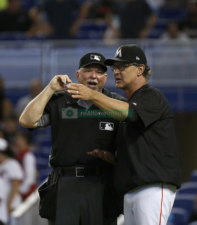 June 21, 2017 - Miami, FL, USA - Miami Marlins manager Don Mattingly argues with home plate base umpire Dana DeMuth during the eighth inning of a baseball game on Wednesday, June 21, 2017 at Marlins Park in Miami, Fla. (Credit Image: © David Santiago/TNS via ZUMA Wire)