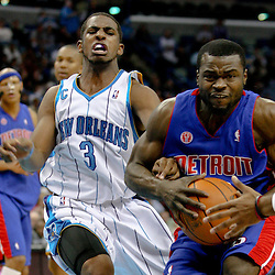 Dec 16, 2009; New Orleans, LA, USA;  Detroit Pistons guard Will Bynum (12) drives past New Orleans Hornets guard Chris Paul (3) during the second half at the New Orleans Arena. The Hornets defeated the Pistons 95-87. Mandatory Credit: Derick E. Hingle-US PRESSWIRE