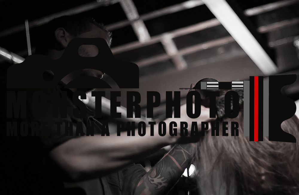 02/12/12 West Chester PA: Hairstylist Ryan Branca from Salon 360 in Pennsylvania working on an unknown model hair during Open Chair 11 Sunday, Feb. 12, 2012 at The Note in West Chester Pennsylvania...Special to Monsterphoto/SAQUAN STIMPSON