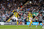 Plymouth Argyle's Curtis Nelson directs a header towards the goal during the Sky Bet League 2 match between Plymouth Argyle and Dagenham and Redbridge at Home Park, Plymouth, England on 23 April 2016. Photo by Graham Hunt.