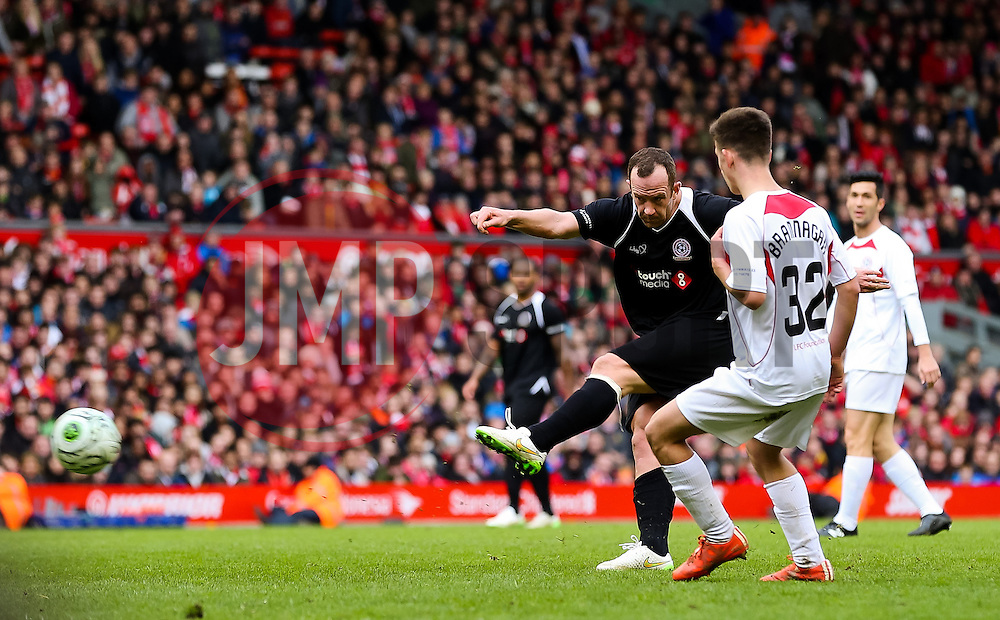 Charlie Adam fires a shot towards goal   - Photo mandatory by-line: Dougie Allward/JMP - Mobile: 07966 386802 - 29/03/2015 - SPORT - Football - Liverpool - Anfield Stadium - Gerrard's Squad v Carragher's Squad - Liverpool FC All stars Game