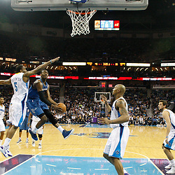 February 1, 2011; New Orleans, LA, USA; Washington Wizards point guard John Wall (2) shoots past New Orleans Hornets guard Marcus Thornton (5) during the second quarter at the New Orleans Arena.   Mandatory Credit: Derick E. Hingle