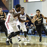Erie BayHawks Guard Seth Curry (12) drives towards the baseline as Delaware 87ers Forward Victor Rudd (23) and Delaware 87ers Guard Jamal Jones (22) defends in the first half of a NBA D-league regular season basketball game between the Delaware 87ers and the Erie BayHawk (Orlando magic) Friday, Jan. 02, 2015 at The Bob Carpenter Sports Convocation Center in Newark, DEL