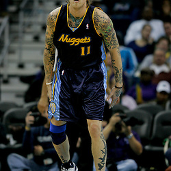 Dec 18, 2009; New Orleans, LA, USA; Denver Nuggets center Chris Andersen (11) on the court against the New Orleans Hornets during the second half at the New Orleans Arena. The Hornets defeated the Nuggets 98-92. Mandatory Credit: Derick E. Hingle-US PRESSWIRE