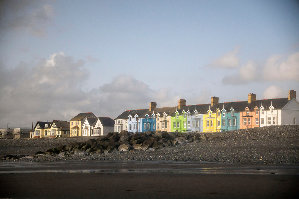 BORTH, WALES, UK 17TH AUGUST 2019 - View over Row of colourful houses in Borth coastal village, County of Ceredigion, Mid Wales, UK.