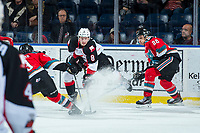 KELOWNA, CANADA - NOVEMBER 29: Jackson Leppard #8 of the Prince George Cougars tries to shoot the puck between Marek Skvrne #9 and Leif Mattson #28 of the Kelowna Rockets on November 29, 2017 at Prospera Place in Kelowna, British Columbia, Canada.  (Photo by Marissa Baecker/Shoot the Breeze)  *** Local Caption ***
